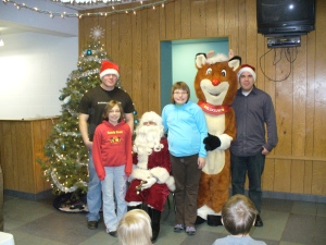 Santa Dave with his helpers and Amy and Ali.